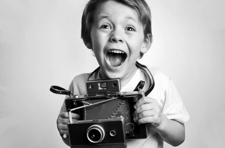 excited kid photographer