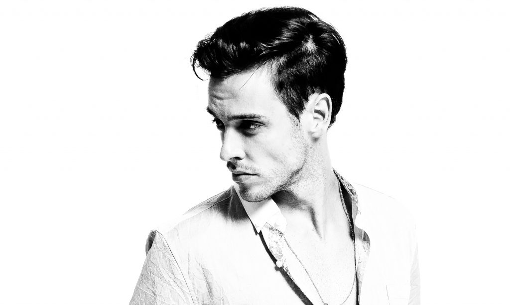 black and white portrait of attractive man looking left