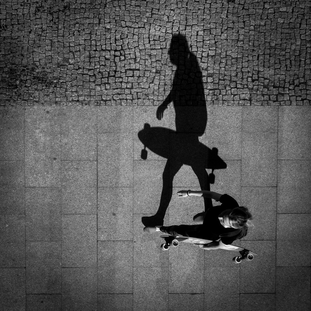 Overhead perspective of long boarder portrait photography