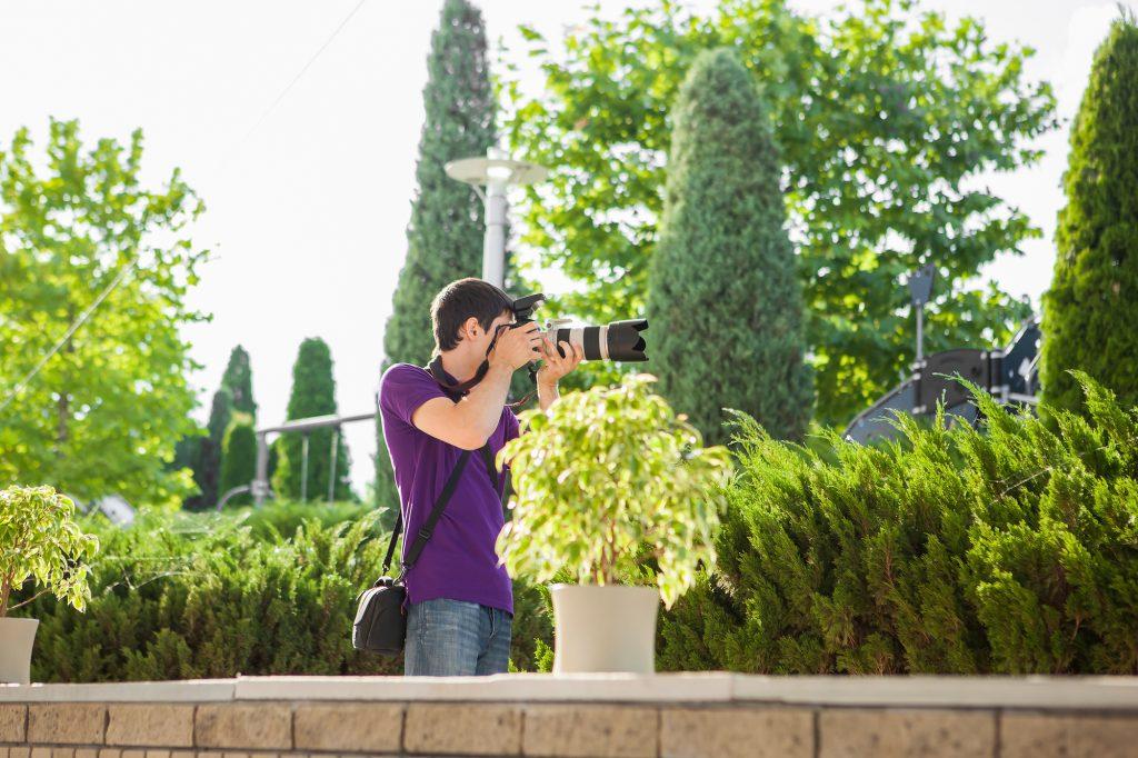 Wedding photographer taking photographs of wedding