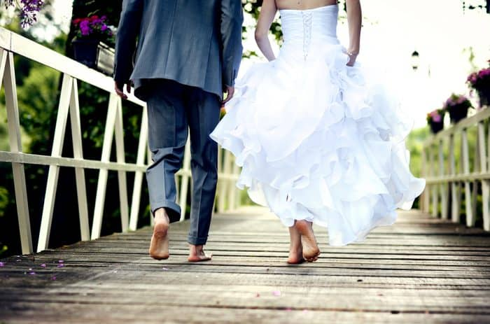 barefoot wedding couple walking