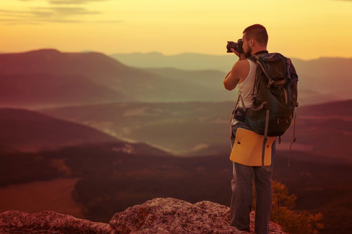 travel photographer on a mountain