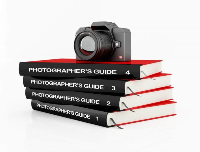 online photography guide book stack and camera