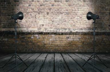 an improvised photo studio brick wall backdrop