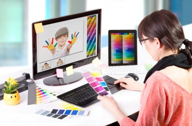 graphic designer working with free photoshop overlays
