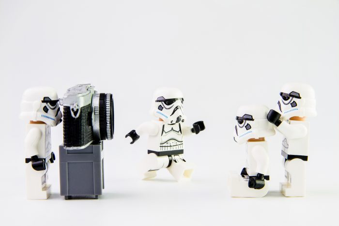 lego stormtroopers taking a photograph