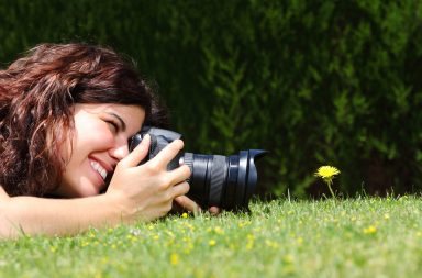girl practicing microphotography with a flower