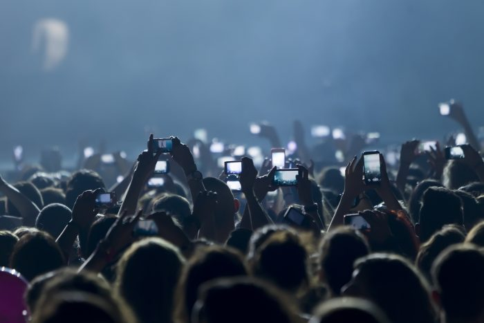 photo of many people at a concert event photography