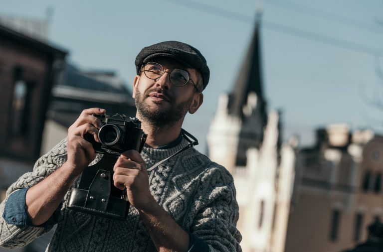 one of the famous photographers taking pictures with a vintage camera