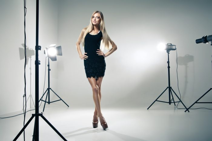 fashion girl posing in a fashion photography studio