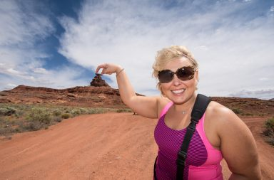 Woman shows a forced perspective view of a mountain