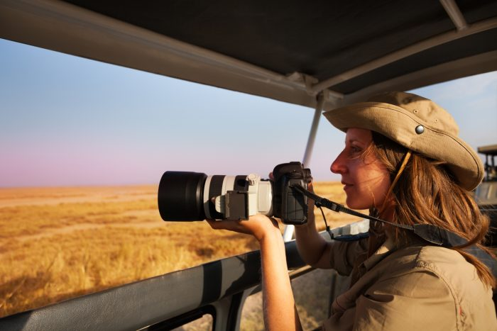 woman doing wildlife photography as one of the types of photography