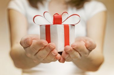 wrapped gift in girl's hands
