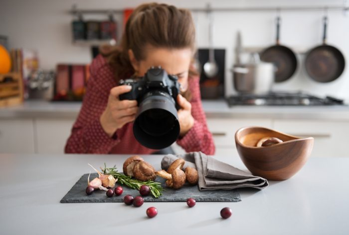 woman photographing food details with her camera
