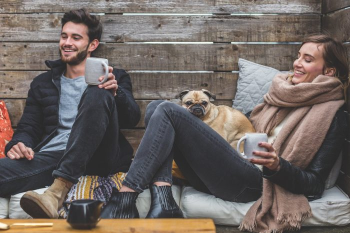 couple with a dog enjoying a cup of coffee
